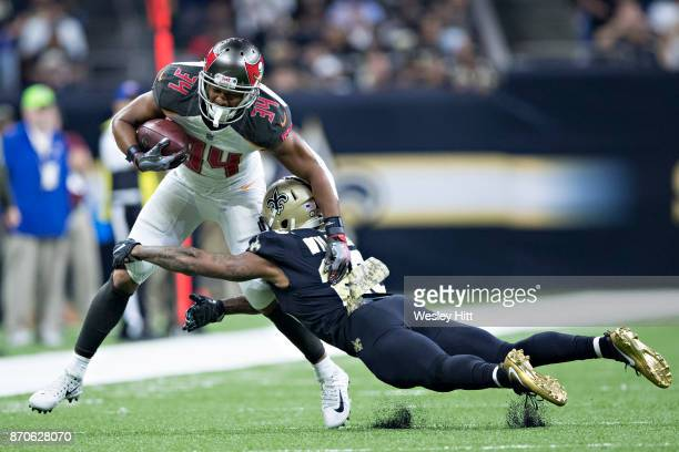 Charles Sims III of the Tampa Bay Buccaneers runs the ball and is tackled by PJ Williams of the New Orleans Saints at MercedesBenz Superdome on...