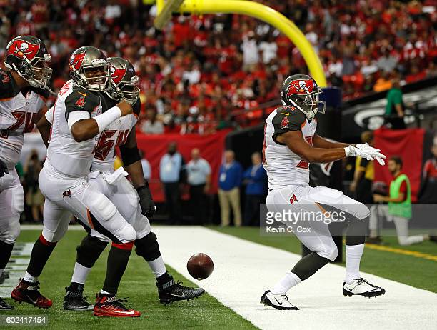 Charles Sims of the Tampa Bay Buccaneers celebrates scoring a touchdown against the Atlanta Falcons at Georgia Dome on September 11 2016 in Atlanta...