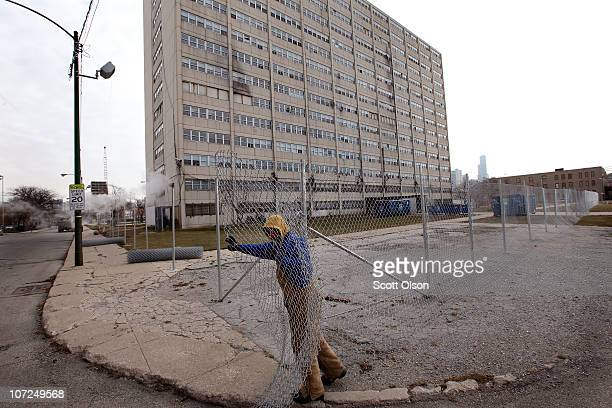 Charles Smith installs a fence around 1230 N Burling St the last occupied highrise in the CabriniGreen public housing complex on December 2 2010 in...