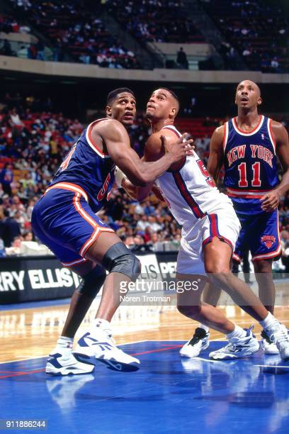 Charles Smith of the New York Knicks boxes out during a game played on December 27 1994 at the Continental Airlines Arena in East Rutherford New...
