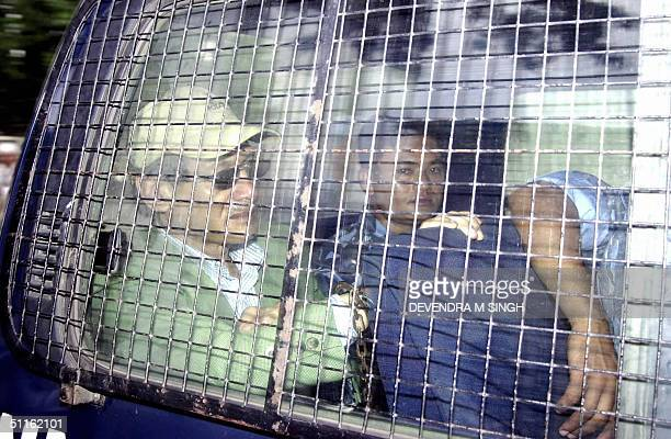 Charles Sobhraj , the infamous serial killer of Western backpackers in Asia in the 1970s, sits in a police van following a hearing at Kathmandu's...