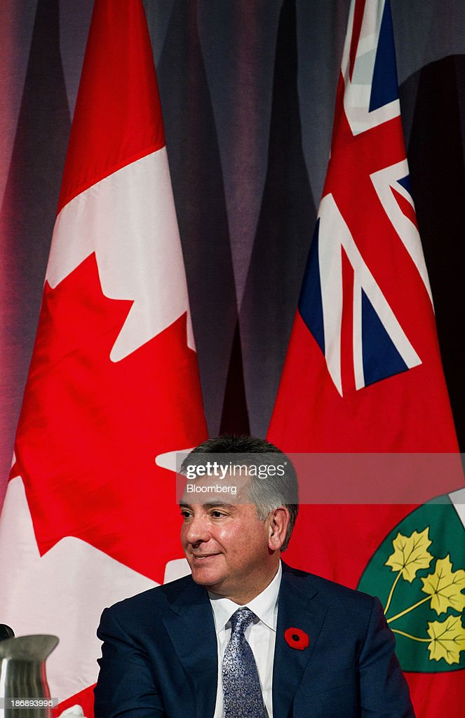 Charles Sousa, Ontario's finance minister, smiles before speaking at the Empire Club of Canada in Toronto, Ontario, Canada, on Monday, Nov. 4, 2013. Ontario, Canada's largest province by population, is considering tax measures to encourage investment and boost productivity, Sousa said today. Photographer: Galit Rodan/Bloomberg via Getty Images Charles Sousa
