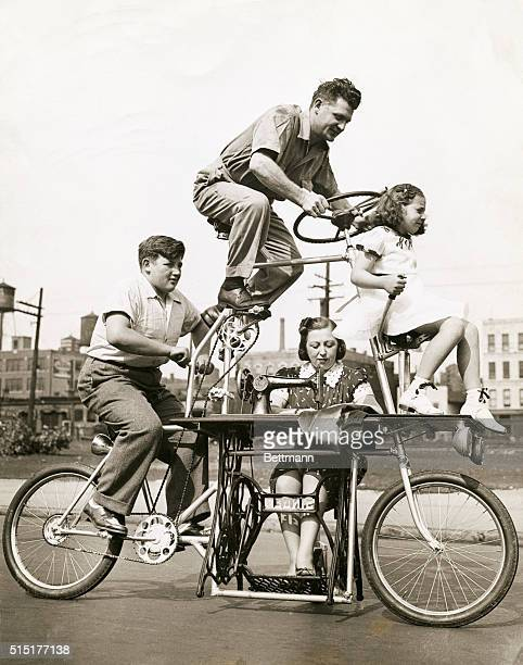 Charles Steinlauf and his family take a ride on his invention a fourposition bicycle which also contains a builtin sewing machine Charles rides on...