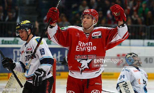 Charles Stephens of Koeln celebrates after scoring his teams first goal during the DEL match between Koelner Haie and ERC Ingolstadt at Lanxess Arena...