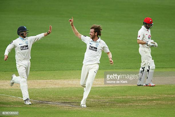 Charles Stobo of the NSW Blues celebrates after getting the wicket of Callum Ferguson of the SA Redbacks during day three of the Sheffield Shield...