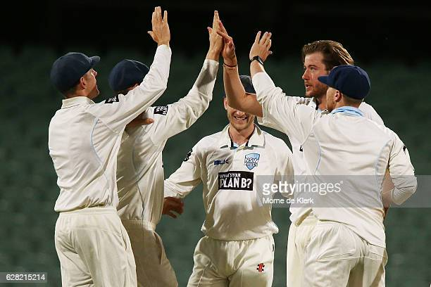 Charles Stobo of the NSW Blues celebrates with teammates after taking the wicket of Kane Richardson of the SA Redbacks during day three of the...
