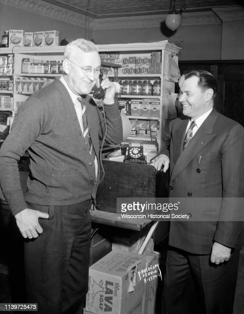 Charles T Davies Mazomanie representative of the Wisconsin Telephone Company receives the first dial telephone call to be handled through the...