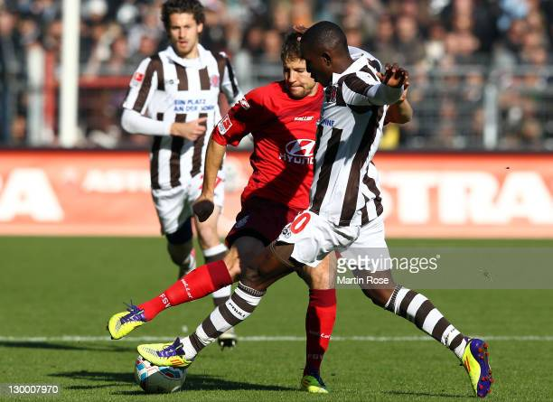 Charles Takyi of StPauli and Vyacheslav Hleb of Frankfurt battle for the ball during the Second Bundesliga match between FC St Pauli and FSV...