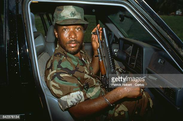 Charles Taylor leader of the National Patriotic Front of Liberia is taking his forces to Buchanan Liberia Responding to years of government...