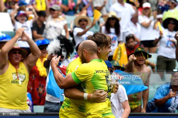 Charles Taylor of Australia celebrates scoring a try in the quarter final match against New Zealand during day three of the 2018 Sydney Sevens at...
