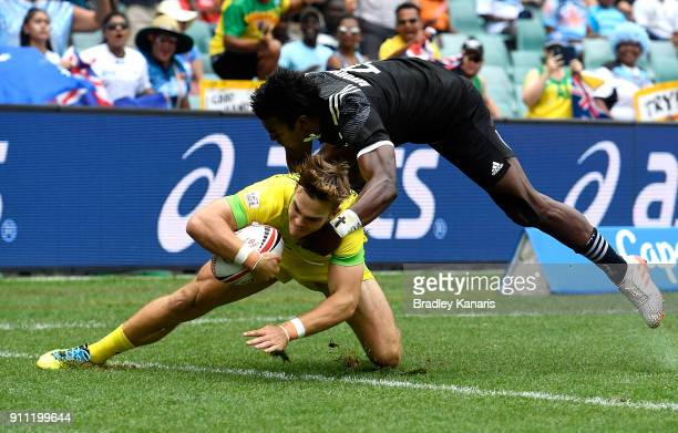 Charles Taylor of Australia scores a try in the quarter final match against New Zealand during day three of the 2018 Sydney Sevens at Allianz Stadium...