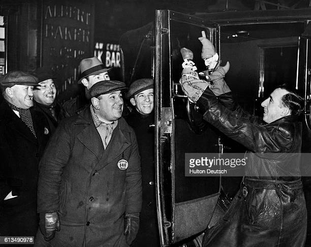 Charles Tebbutt a London taxi driver puts on a show for his fellow workers using puppets he has made himself England ca 1937