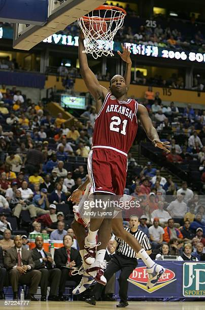 Charles Thomas of the Arkansas Razorbacks drives for a dunk attempt against the Florida Gators during day 2 of the SEC Men's Basketball Conference...