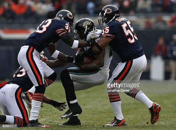 Charles Tillman and Lance Briggs of the Chicago Bears tackle Fred Taylor of the Jacksonville Jaguars on December 7 2008 at Soldier Field in Chicago...
