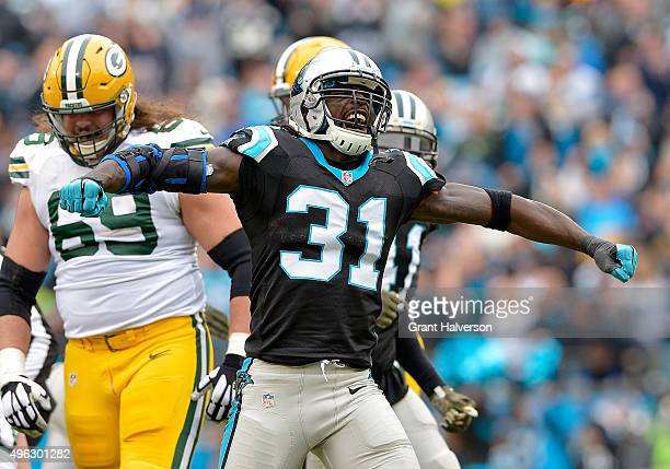 Charles Tillman of the Carolina Panthers celebrates after forcing a fumble by the Green Bay Packers during their game at Bank of America Stadium on...