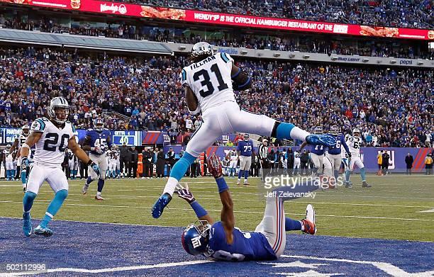 Charles Tillman of the Carolina Panthers intercepts a ball intended for Hakeem Nicks of the New York Giants in the fourth quarter during their game...
