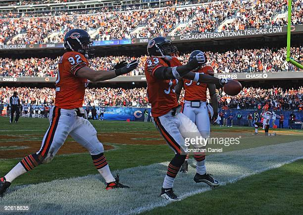 Charles Tillman of the Chicago Bears celebarates an interception and a touchdown run with Hunter Hillenmeyer and Mark Anderson against the Cleveland...