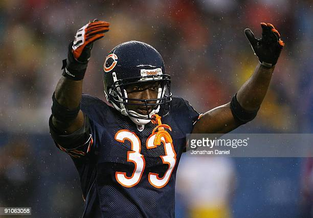Charles Tillman of the Chicago Bears encourages fans to cheer during a game against the Pittsburgh Steelers on September 20 2009 at Soldier Field in...
