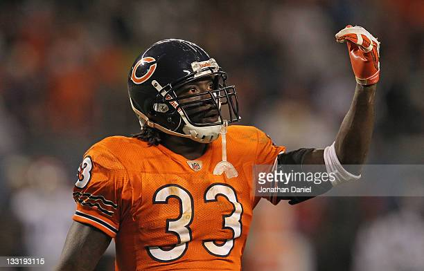 Charles Tillman of the Chicago Bears encourages the crowd against the Detroit Lions at Soldier Field on November 13 2011 in Chicago Illinois The...