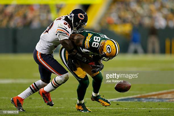Charles Tillman of the Chicago Bears forces a fumble by Jermichael Finley of the Green Bay Packers during the game at Lambeau Field on September 13...