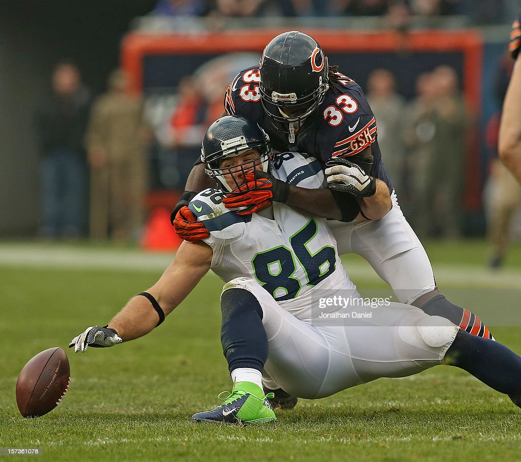 Charles Tillman #33 of the Chicago Bears gets his hands inside the facemask of Zach Miller #86 of the Seattle Seahawks while breaking up a pass at Soldier Field on December 2, 2012 in Chicago, Illinois. The Seahawks defeated the Bears 23-17 in overtime.