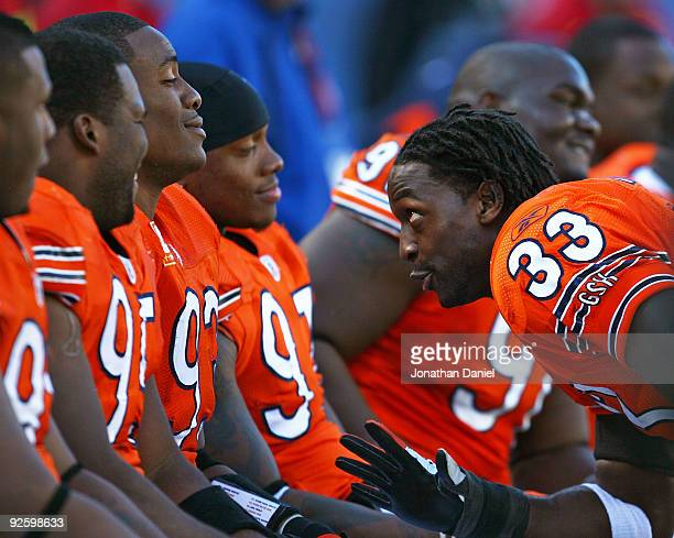 Charles Tillman of the Chicago Bears jokes with teammates on the bench including Anthony Adams Adewale Ogunleye Mark Anderson and Tommie Harris...