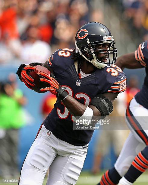 Charles Tillman of the Chicago Bears returns his second interception of the game against the Cincinnati Bengals at Soldier Field on September 8 2013...