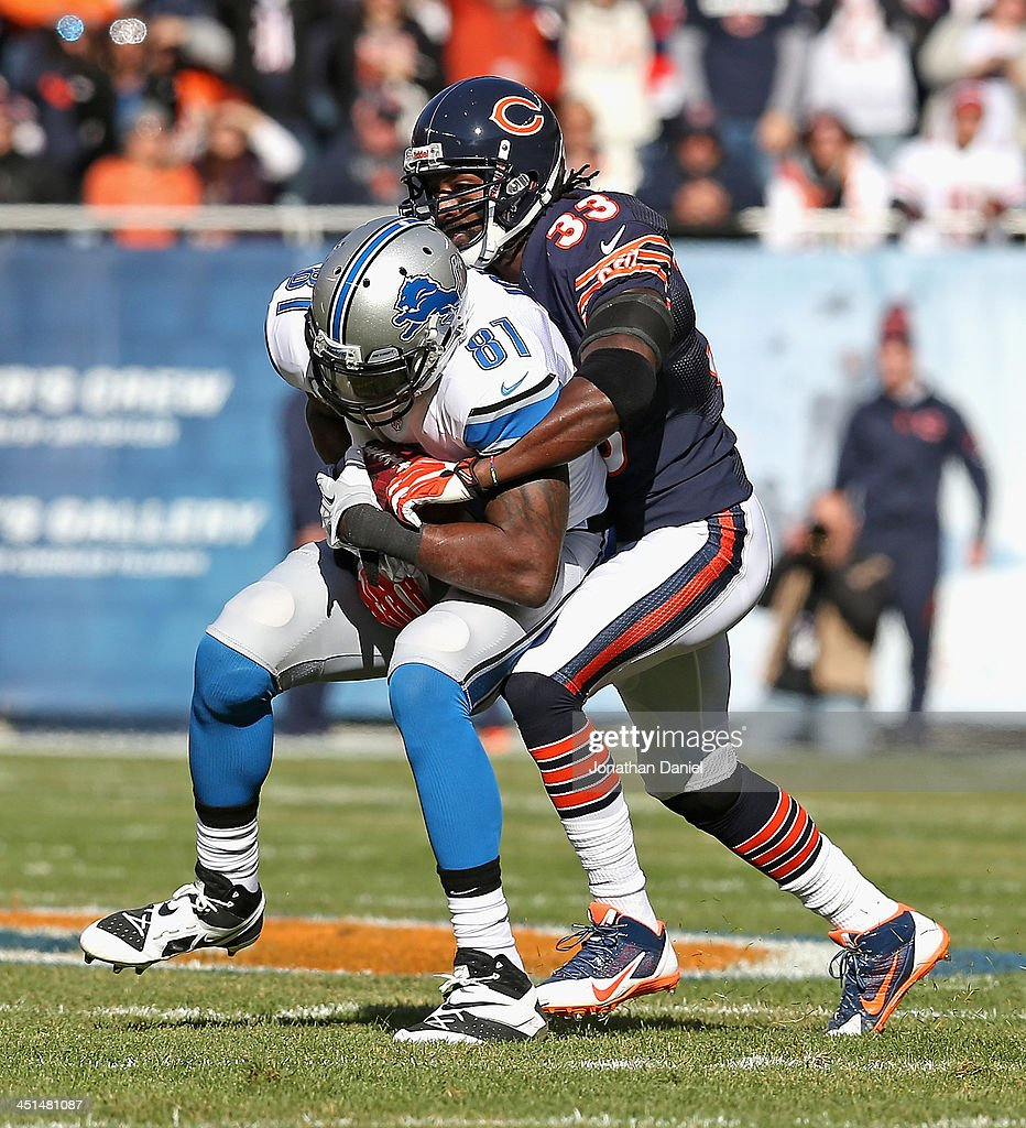 Charles Tillman #33 of the Chicago Bears tackles Calvin Johnson #81 of the Detroit Lions at Soldier Field on November 10, 2013 in Chicago, Illinois. The Lions defeated the Bears 21-19.