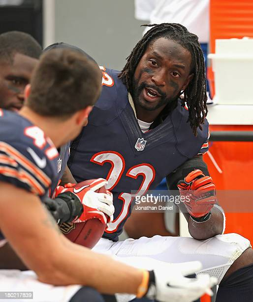 Charles Tillman of the Chicago Bears talks with teammates on the bench during a game against the Cincinnati Bengals at Soldier Field on September 8...