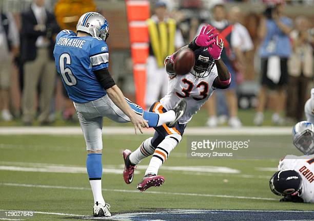 Charles Tillman of the Chicago Bears tries to block a fourth quarter punt off the foot of Ryan Donahue of the Detroit Lions at Ford Field on October...