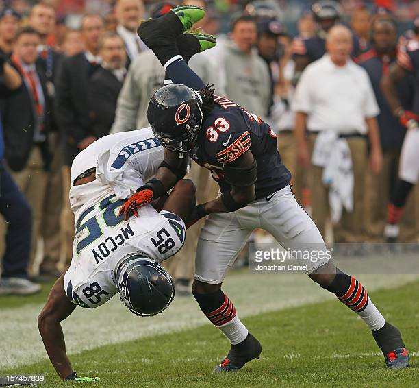 Charles Tillman of the Chicago Bears upends Anthony McCoy of the Seattle Seahawks at Soldier Field on December 2 2012 in Chicago Illinois The...