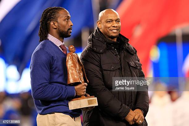 Charles Tillman wins Walter Payton NFL Player of Year trophy prior to Super Bowl XLVIII at MetLife Stadium on February 2 2014 in East Rutherford New...