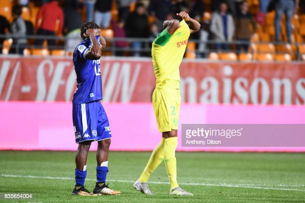 Charles Traore of Troyes and Najib Gandi of Nantes exchange their jersey during the Ligue 1 match between Troyes Estac and FC Nantes at Stade de...