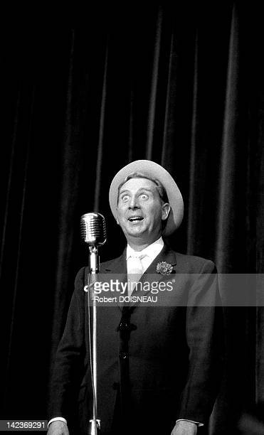 Charles Trenet singing on stage at Bobino on September 26 1955 in Paris France
