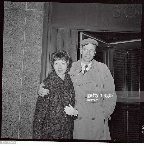 Charles Van Doren and his wife Geraldine pause outside the courtroom here where he pleaded guilty to lying about his appearances on rigged TV shows...
