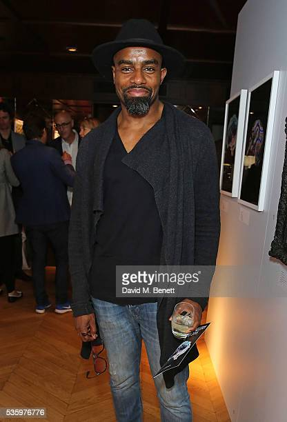 Charles Venn attends the Olumide Gallery's new exhibition exploring socioeconomic issues through inspiring sculptures prints paintings and neon from...