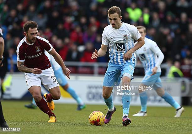 Charles Vernam of Coventry City plays the ball watched by Neal Eardley of Northampton Town during the Sky Bet League One match between Northampton...