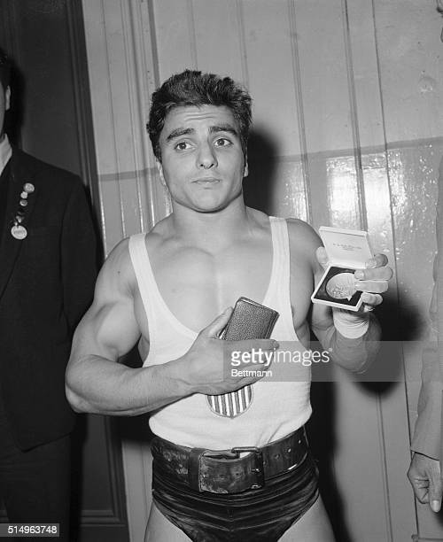 Charles Vinci of York Pennsylvania displays his Olympic Gold medal here November 23rd after winning the bantam weight weight lifting competition The...