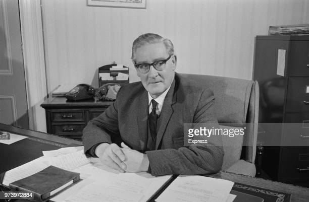 Charles W Lloyd Headmaster of Dulwich College, pictured seated at his desk in the Master's office at Dulwich College in south London on 22nd February...