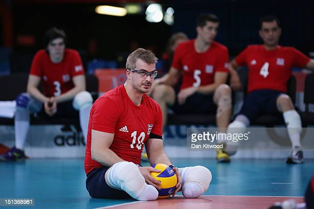 Charles Walker of Great Britain waits to serve during the Men's Sitting Volleyball 58 Clasification match against Brazil on day 8 of the London 2012...