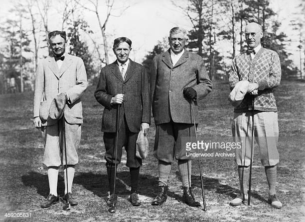 Charles Webb Harvey Firestone Charles Schwab and Herbert Miles take a break during their golf game Asheville North Carolina circa 1924