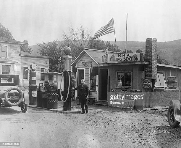 Charles Woodcock of Painted Post NY has the only KKK filling station in the East He has to stand for jeering and abuse from passing motorists but...