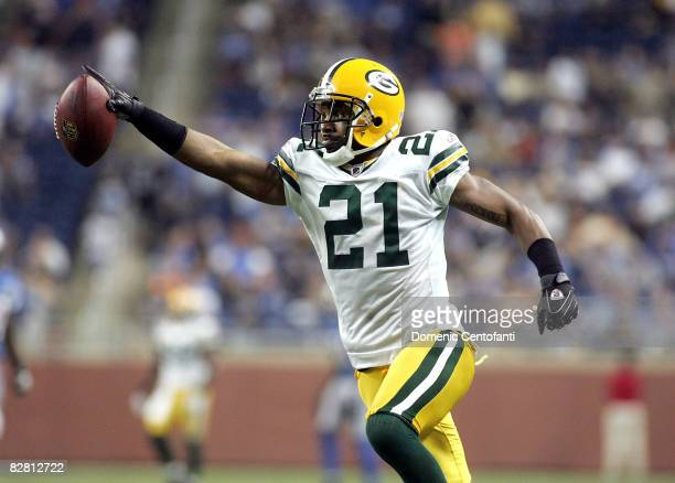 Charles Woodson intercepts a pass from Jon Kitna and returns it for a touchdown against the Detroit Lions on September 14, 2008 at Ford Field in...