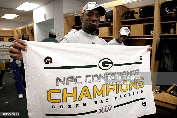 Charles Woodson of the Green Bay Packers celebrates in the locker room after the Packers 21-14 victory against the Chicago Bears in the NFC...