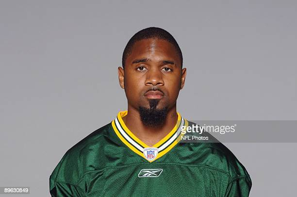 Charles Woodson of the Green Bay Packers poses for his 2009 NFL headshot at photo day in Green Bay Wisconsin