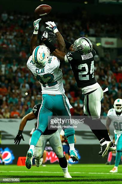 Charles Woodson of the Oakland Raiders breaks up a pass intended for Charles Clay of the Miami Dolphins during the NFL match between the Oakland...