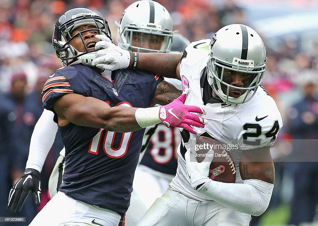 Charles Woodson #24 of the Oakland Raiders breaks way from Marquess Wilson #10 of the Chicago Bears after intercepting a pass in the 4th quarter at Soldier Field on October 4, 2015 in Chicago, Illinois. The Bears defeated the Raiders 22-20.