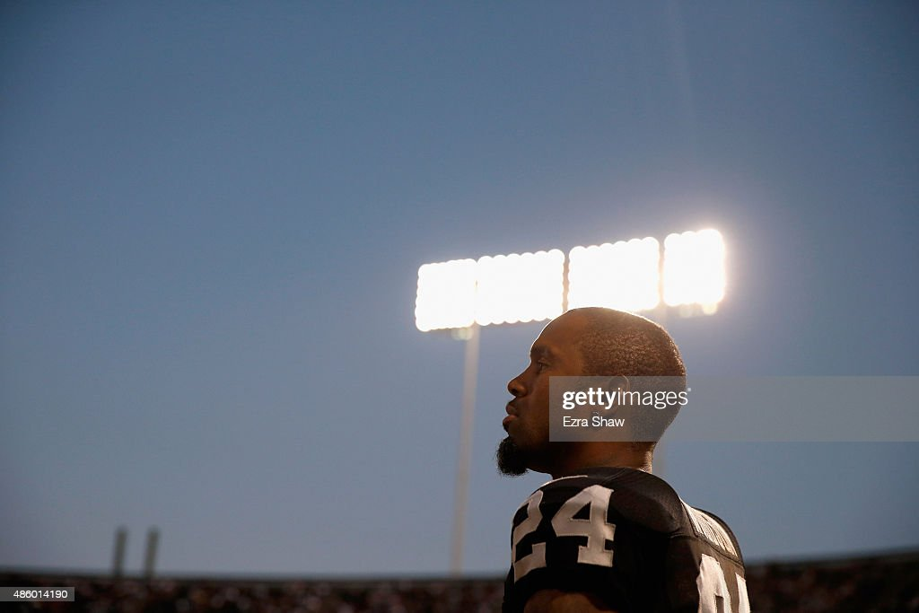 Charles Woodson #24 of the Oakland Raiders stands on the sidelines during their game against the Arizona Cardinals at O.co Coliseum on August 30, 2015 in Oakland, California.