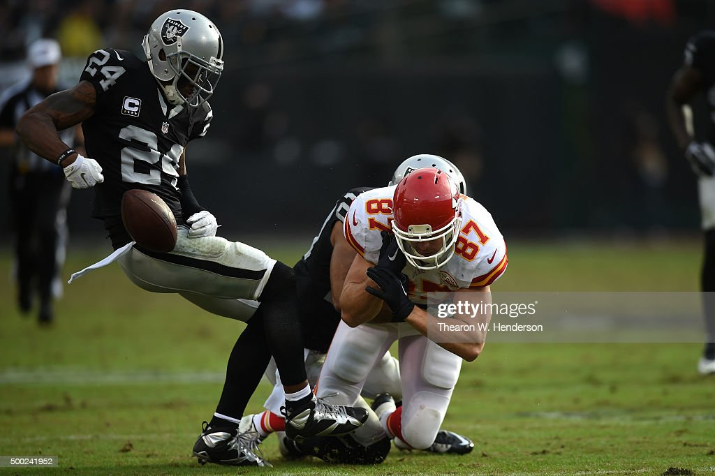 Charles Woodson #24 of the Oakland Raiders strips the ball from Travis Kelce #87 of the Kansas City Chiefs during their NFL game at O.co Coliseum on December 6, 2015 in Oakland, California.
