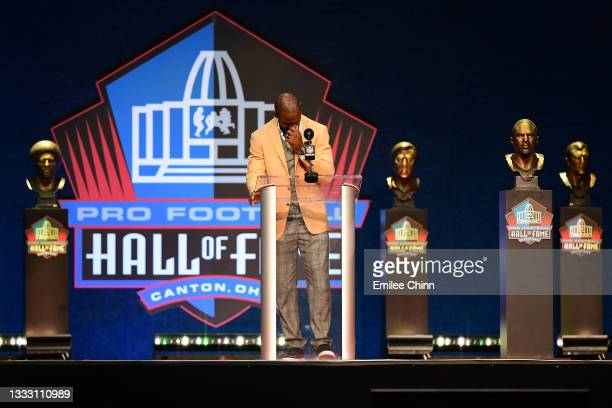 Charles Woodson reacts while giving his speach during the NFL Hall of Fame Enshrinement Ceremony at Tom Benson Hall Of Fame Stadium on August 08,...